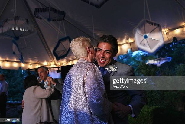 TV reporter Roby Chavez and his newly wedded husband Chris Roe dance with each others mothers Lydia Griffin and Karen Roe during their wedding...