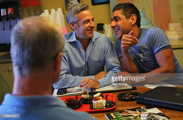 TV reporter Roby Chavez and his partner Chris Roe share a moment as they pick their wedding cake at a bakery July 30 2010 in Alexandria Virginia...