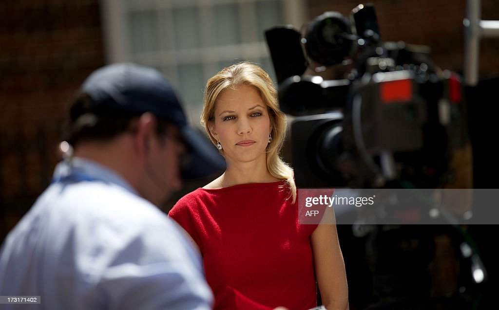 A TV reporter sets up for a report outside The Lindo Wing of Saint Mary's Hospital in Paddington, west London on July 9, 2013. Prince William and his wife Catherine's baby, which will be third in line to the throne, will be born in the private Lindo wing of St Mary's Hospital, where William was born in 1982 and his brother Harry in 1984.