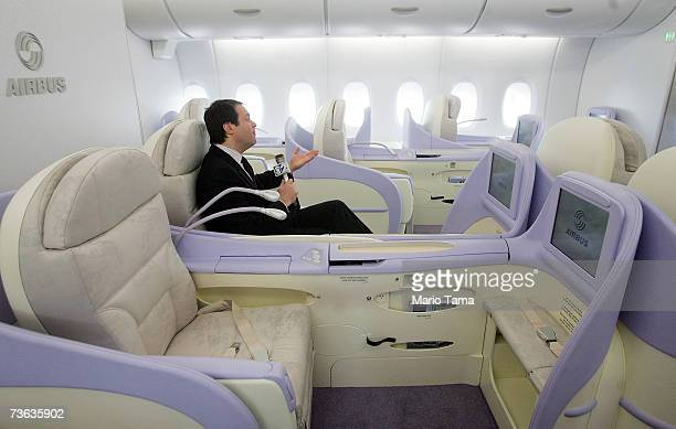 A reporter sits in a firstclass seat of the new doubledecker Lufthansa Airbus A380 after it arrived at JFK International Airport following its first...