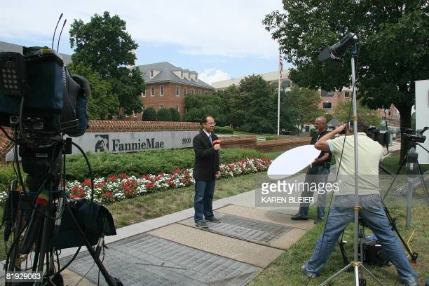 A reporter speaks in front of Fannie Mae headquarters on July 14 2008 in Washington DC Shares in Fannie Mae and Freddie Mac appeared to steady Monday...