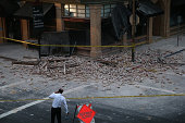 A reporter surveys the scene of a building collapse following a reported 60 earthquake on August 24 2014 in Napa California A 60 earthquake rocked...