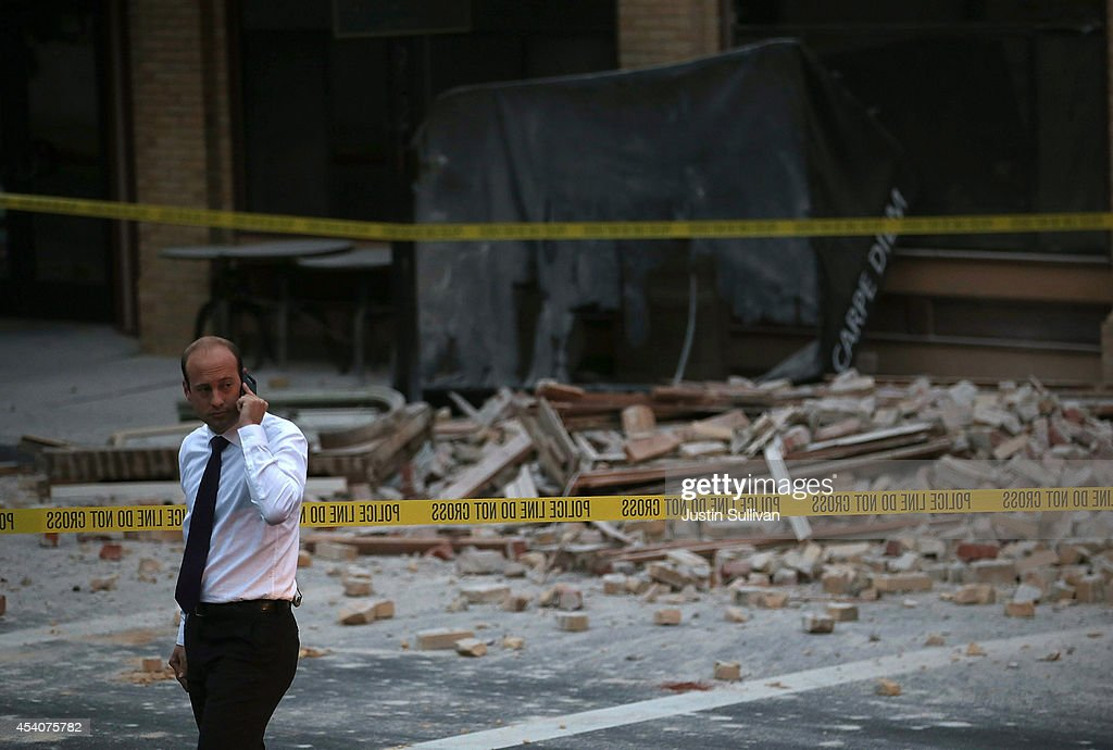 A reporter surveys the scene of a building collapse following a reported 6.0 earthquake on August 24, 2014 in Napa, California. A 6.0 earthquake rocked the San Francisco Bay Area shortly after 3:00 am on Sunday morning causing damage to buildings and sending at least 70 people to a hospital with non-life threatening injuries.