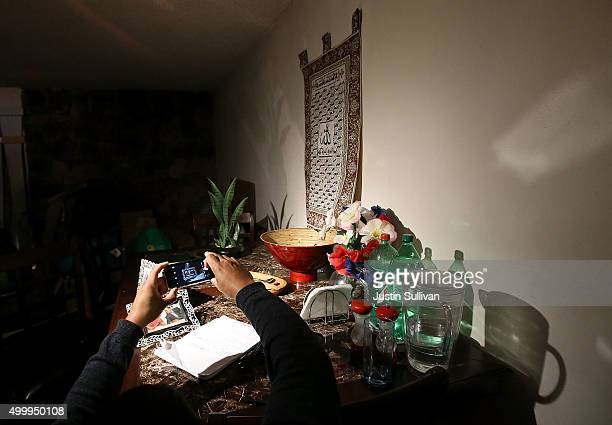 A reporter takes a photo of a dining room table inside the home of shooting suspect Syed Farook on December 4 2015 in Redlands California The San...