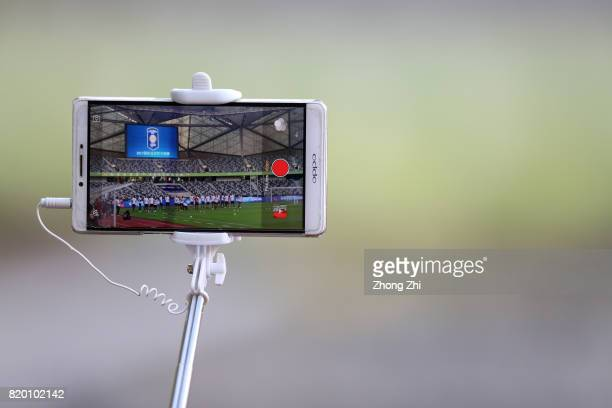 A reporter use Oppo smart phone to take video of AC Milan practice during the training session ahead of the 2017 International Champions Cup football...