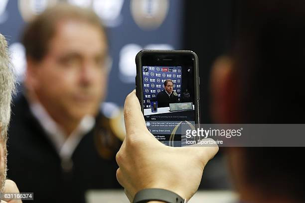 A reporter uses Facebook Live to broadcast Alabama Crimson Tide head coach Nick Saban as he talks to members of the media during Media Day for the...