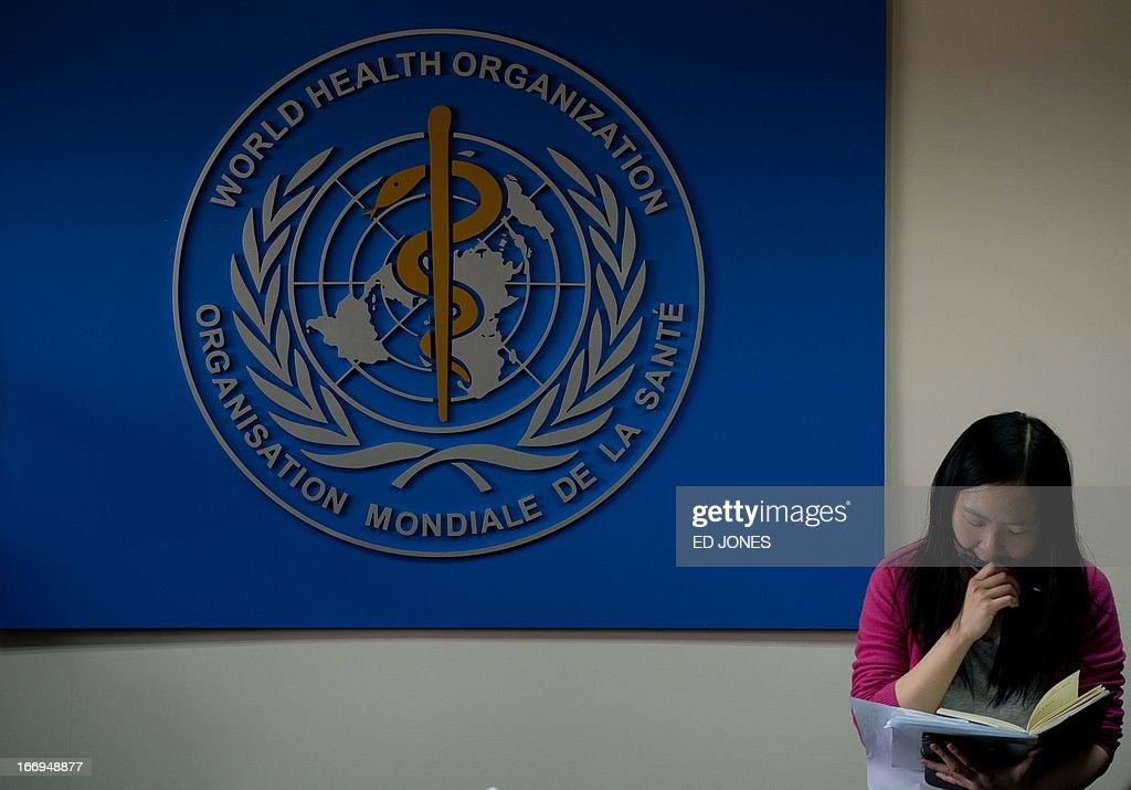 A reporter waits for World Health Organisation (WHO) representative Michael O'Leary to give a press conference in Beijing on April 19, 2013. China has confirmed a total of 82 human cases of H7N9 avian influenza since announcing about two weeks ago that it had found the strain in people for the first time. AFP PHOTO / Ed Jones