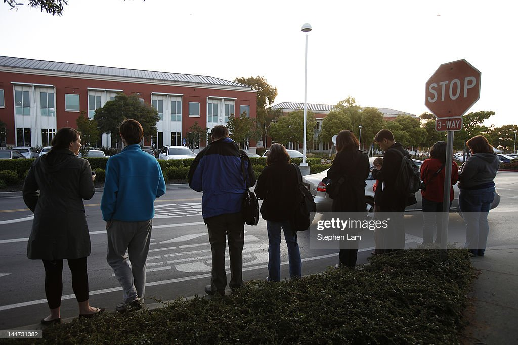 Reporters and onlookers outside Facebook headquarters May 18, 2012 in Menlo Park, California. The eight-year-old social network company listed their initial public offering on NASDAQ Friday morning at $38 a share and a valuation of $104 billion, making its IPO the third largest in U.S. history after General Motors and Visa.