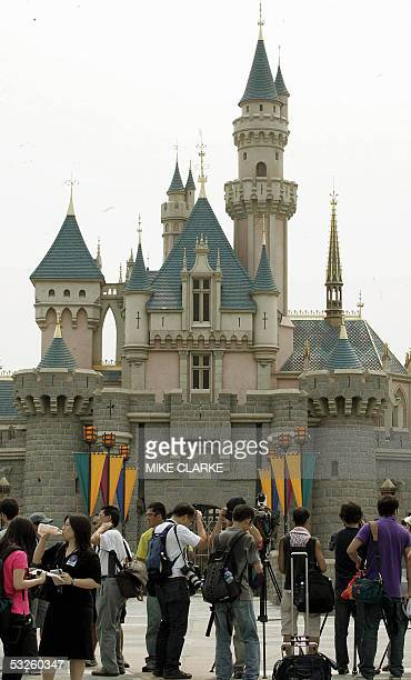 Reporters and photographer get a preview of Walt Disney's Sleeping Beauty Castle at the Disneyland theme park in Hong Kong 20 July 2005 The 'Hong...