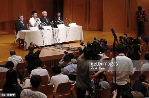 Reporters and photographers gather at baseball slugger Kotaro Kiyomiya's press conference at his Waseda Jitsugyo high school in Tokyo on Sept 22 2017...