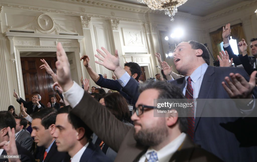 Reporters attempt to pose questions to U.S. President Donald Trump during a news conference announcing Alexander Acosta as the new Labor Secretary nominee in the East Room at the White House on February 16, 2017 in Washington, DC. The announcement comes a day after Andrew Puzder withdrew his nomination.