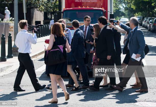 Reporters follow Rep Justin Amash RMich across the street as he leaves the House Republican Conference meeting at the Capitol Hill Club in Washington...