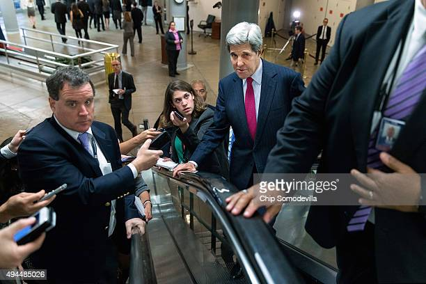 Reporters follow US Secretary of State John Kerry up an escaltor after he testified to the Senate Foreign Affairs Committee about Syria during a...