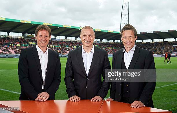 Reporters from Canal9 Flemming Povlsen Michael Gravgaard and Troels Bech pose for a group shot in halftime during the Danish Alka Superliga match...