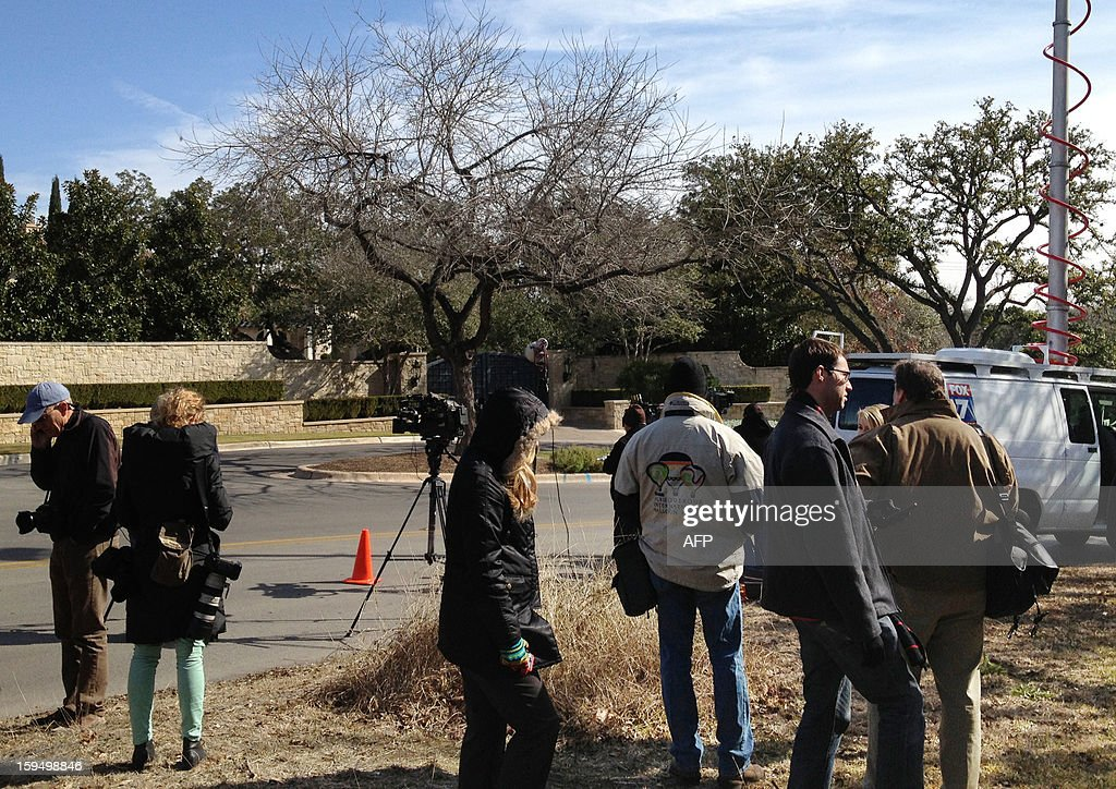 Reporters gather in front of cyclist Lance Armstrong's house in Austin, Texas, January 14, 2013. Armstrong is scheduled to appear on US talk show host Oparh Winfrey's OWN cable network to be broadcast on January 17, 2013. Armstrong's decision to talk to the famed US talk show host has divided opinion, as some say he needs to do something radical to rehabilitate his public profile, while others say speaking out will only make matters worse. The crux of the matter is whether Armstrong, having been stripped of his seven Tour de France titles, will finally admit that he was a drugs cheat. Such a confession would overturn more than a decade of strenuous denials. AFP PHOTO Charles BOISSEAU