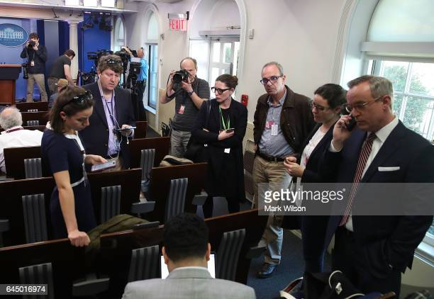 Reporters in the Brady Briefing Room listen to a tape from a press gaggle by White House Press Secretary Sean Spicer on February 24 2017 in...