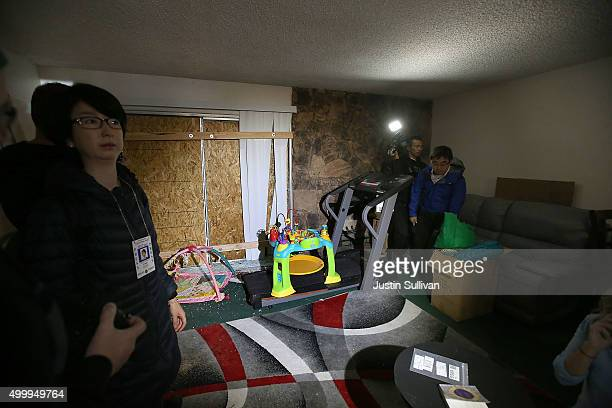 Reporters inspect the home of shooting suspect Syed Farook on December 4 2015 in Redlands California The San Bernardino community is mourning as...
