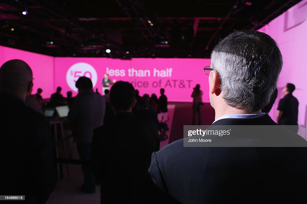 Reporters listen as John Legere, CEO and President of T-Mobile USA makes an announcement during an event about new contract pricing on March 26, 2013 in New York City. Legere confirmed that T-Mobile will start carrying the iPhone 5 starting April 12, under it's new no-contract plan called The Simple Choice, with the customers paying $99 down, then $20 a month for 24 months, on top of the monthly service plan.