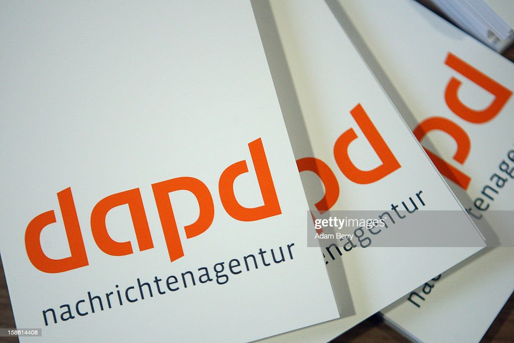 Reporters' notebooks lie on a table in the headquarters of the dapd news agency on December 21, 2012 in Berlin, Germany. The financial newswire Dow Jones is to replace Associated Press as an international distribution partner for the insolvent news agency dapd. Former CEO of N24 television Ulrich Ende is serving as a new investor in Germany's second-largest news agency, which declared bankruptcy in October and fired one hundred, or one-third, of its employees the following month.