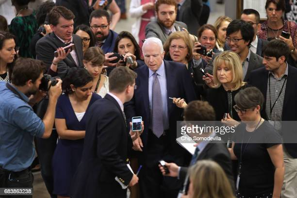 Reporters surround Sen John McCain as he heads for his party's weekly policy luncheon at the US Capitol May 16 2017 in Washington DC Many Republican...