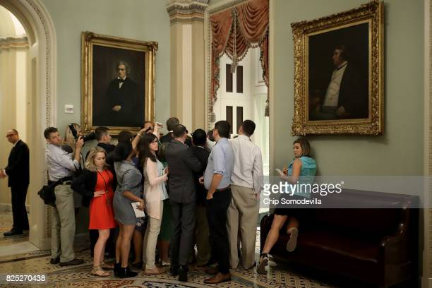 Reporters surround Sen John Thune as he heads into the Senate Republican policy luncheon at the US Capitol August 1 2017 in Washington DC After...