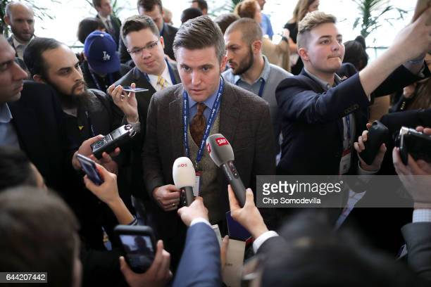 Reporters surround white supremacist Richard Spencer during the first day of the Conservative Political Action Conference at the Gaylord National...
