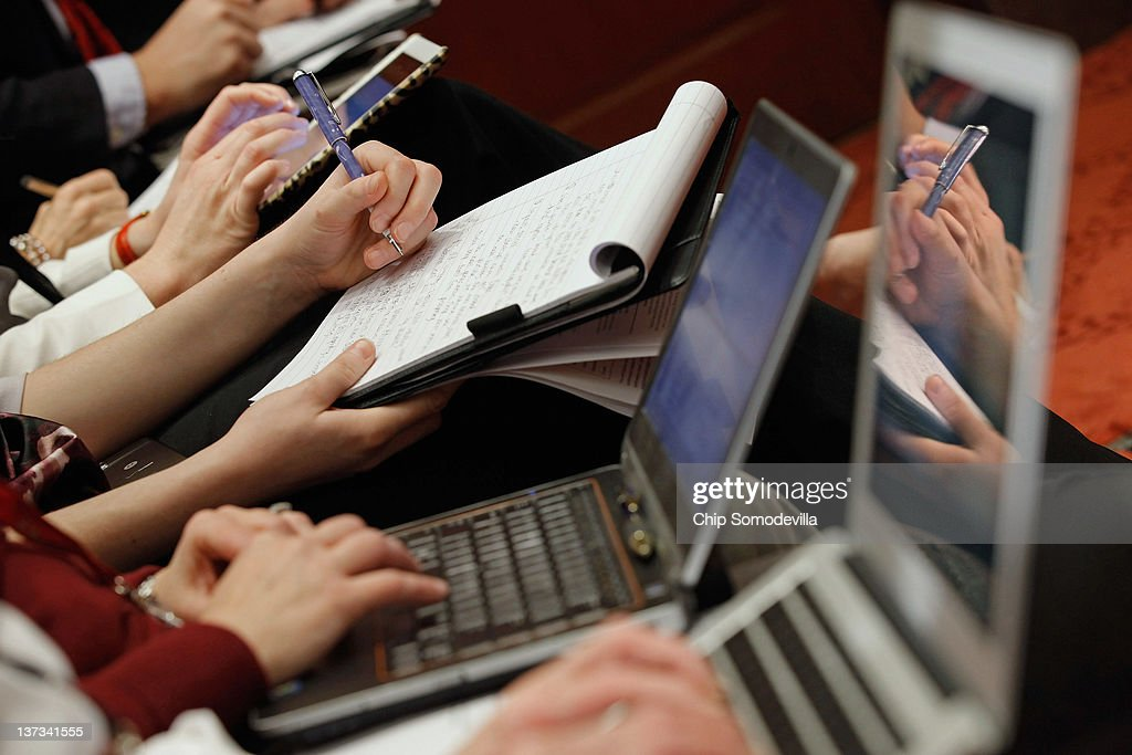 Reporters use laptop computers iPads and ink and paper to take notes during a panel discussion organized by NetCoalition about the Protection IP Act...