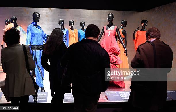 Reporters view some of the fashion designs in the exhibit 'Jacqueline de Ribes The Art of Style' at the Metropolitan Museum of Art November 17 2015...