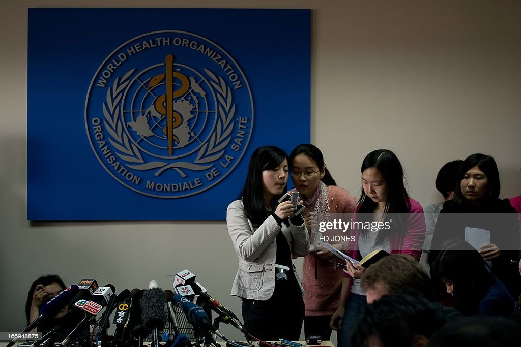 Reporters wait for World Health Organisation (WHO) representative Michael O'Leary to give a press conference in Beijing on April 19, 2013. China has confirmed a total of 82 human cases of H7N9 avian influenza since announcing about two weeks ago that it had found the strain in people for the first time. AFP PHOTO / Ed Jones