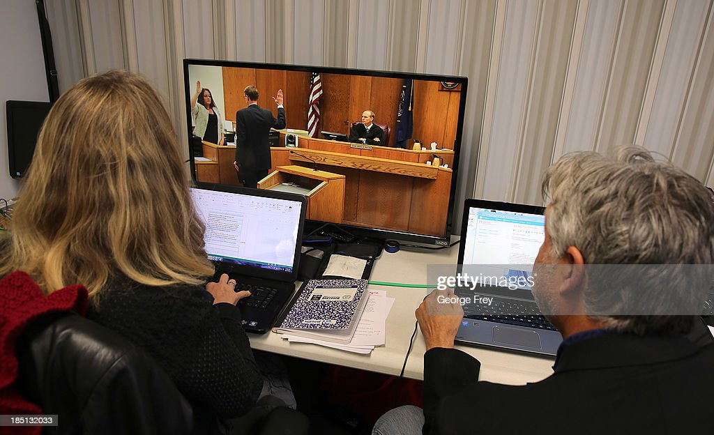 Reporters watch a live feed from the courtroom for the Martin MacNeill trial on October 17, 2013 in Provo, Utah. This is the first live televised trial ever allowed in the state of Utah. Dr. Martin MacNeill is accused of killing his wife Michele MacNeill in 2007 to continue an affair with a younger woman.