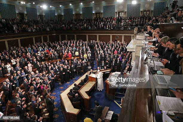 Reporters watch from their gallery as Pope Francis addresses a joint meeting of the US Congress in the House Chamber of the US Capitol on September...