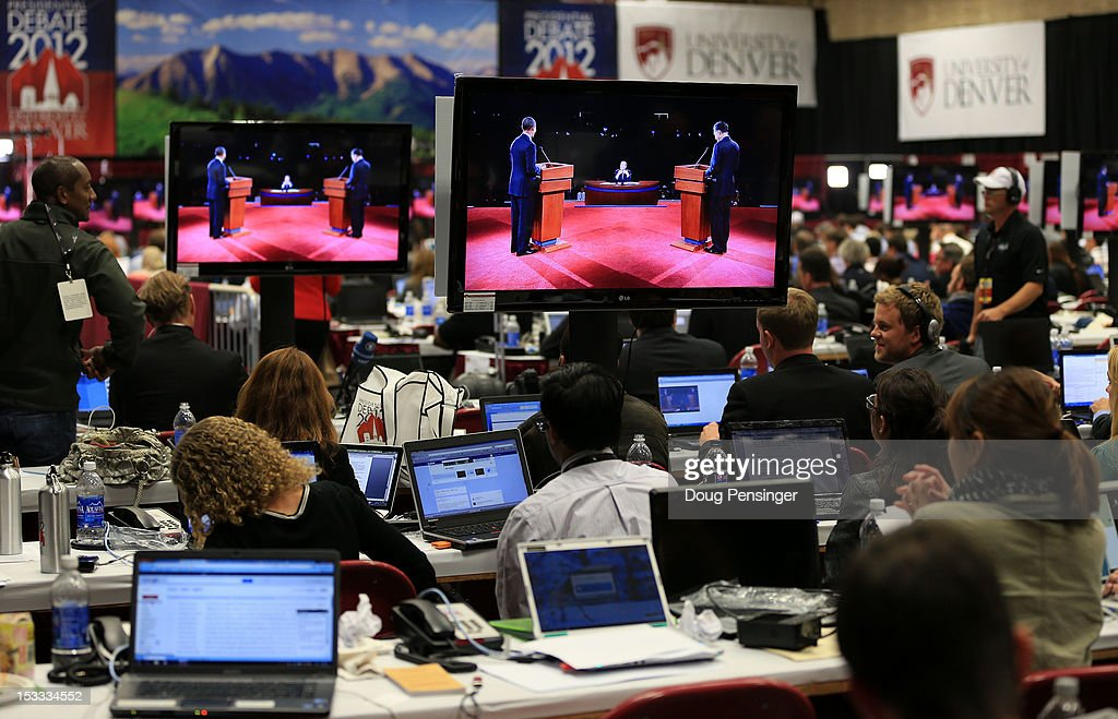 Reporters watch the final minutes of the Presidential Debate between Democratic presidential candidate, U.S. President <a gi-track='captionPersonalityLinkClicked' href=/galleries/search?phrase=Barack+Obama&family=editorial&specificpeople=203260 ng-click='$event.stopPropagation()'>Barack Obama</a> and Republican presidential candidate, former Massachusetts Gov. Mitt Romney at the University of Denver on October 3, 2012 in Denver, Colorado. The first of four debates for the 2012 Election, three Presidential and one Vice Presidential, is moderated by PBS's Jim Lehrer and focuses on domestic issues: the economy, health care, and the role of government.