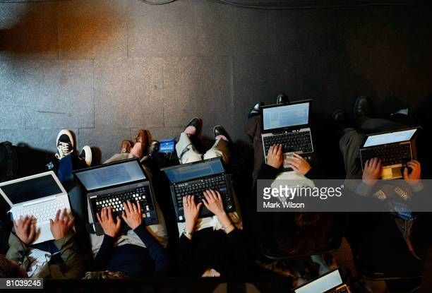 Reporters work on their laptops as Democratic presidential hopeful Sen Barack Obama speaks during a campaign event at Vernier Software Technology May...