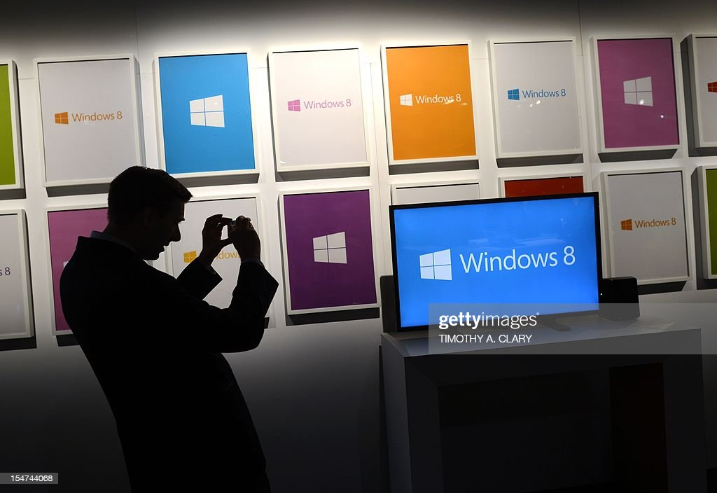 A repoter takes photos before the start of a press conference at Pier 57 to officially launch Windows 8 in New York October 25 2012 Microsoft said...