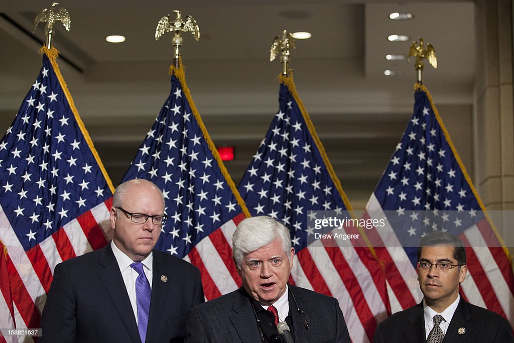 Represenatives Joseph Crowley (D-NY), John Larson (D-CT), and Xavier Becerra (D-CA) hold a news conference about jobs and the 'fiscal cliff' on Capitol Hill, December 30, 2012 in Washington, DC. The House and Senate are both in session today to deal with the looming 'fiscal cliff.' issue.
