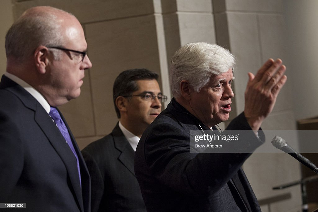 Represenatives Joseph Crowley (D-NY), <a gi-track='captionPersonalityLinkClicked' href=/galleries/search?phrase=Xavier+Becerra&family=editorial&specificpeople=2369133 ng-click='$event.stopPropagation()'>Xavier Becerra</a> (D-CA) and John Larson (D-CT) hold a news conference about jobs and the 'fiscal cliff', on Capitol Hill December 30, 2012 in Washington, DC. The House and Senate are both in session today to deal with the looming 'fiscal cliff.' issue.