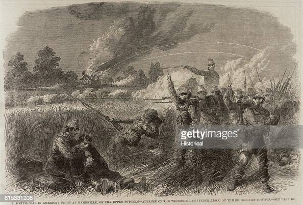 A representation of the battle at Hainsville on the Upper Potomac The Federalist soldiers the Wisconsin men are in the foreground advancing on the...