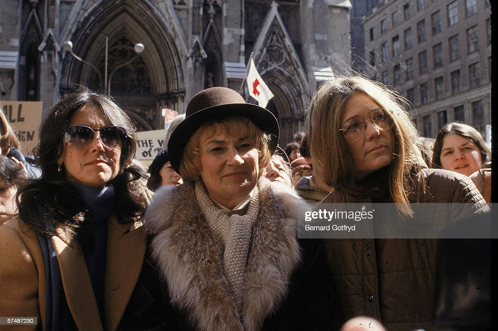 US Representative Bella Abzug (1920 - 1998) (center) and feminist leader <a gi-track='captionPersonalityLinkClicked' href=/galleries/search?phrase=Gloria+Steinem&family=editorial&specificpeople=213078 ng-click='$event.stopPropagation()'>Gloria Steinem</a> (right) outside St. Patrick's Cathedral at a demonstration staged by the Reproductive Rights Committee of the New York City chapter of the National Organization for Women, New York, New York, 1976.