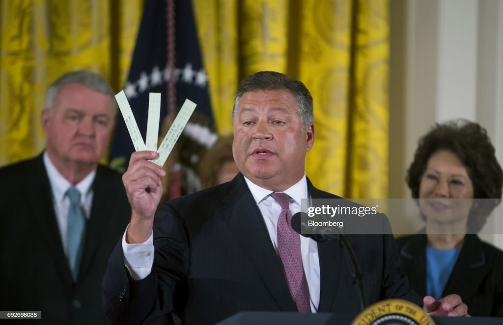 Representative Bill Shuster, a Republican from Pennsylvania and chairman of the House Transportation and Infrastructure Committee, holds pieces of paper used by air traffic controllers to track airplanes after U.S. President Donald Trump, not pictured, announces the Air Traffic Control Reform Initiative during a press conference in the East Room of the White House in Washington, D.C., U.S., on Monday, June 5, 2017. Trumpon Monday unveiled his proposal to hand over control of the U.S. air-traffic control system to a non-profit corporation, calling the current system an antiquated mess that doesnt work and wastes money. Photographer: Eric Thayer/Bloomberg via Getty Images