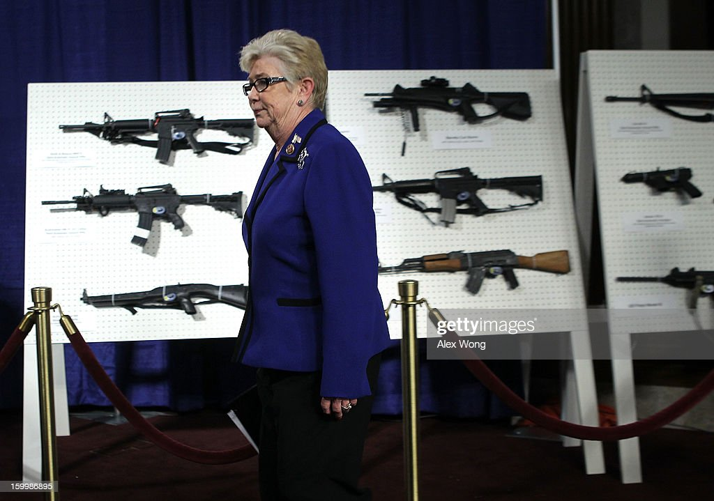 U.S. Representative Carolyn McCarthy (D-NY) passes by a display of assault weapons during a news conference January 24, 2013 on Capitol Hill in Washington, DC. U.S. Senator Dianne Feinstein (D-CA) announced that she will introduce a bill to ban assault weapons and high-capacity magazines capable of holding more than 10 rounds to help to stop gun violence.