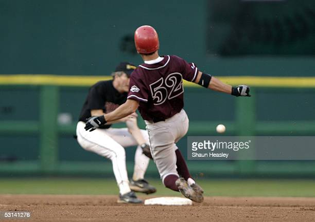 S Representative Chip Pickering slides into second base as US Representative Jim Marshall tries to tag him out during the 44th Annual Congressional...