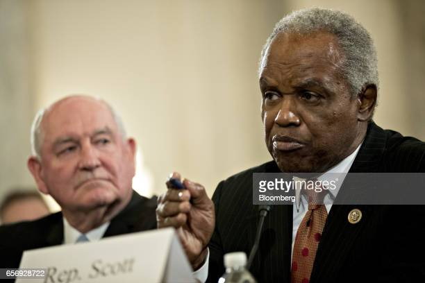 Representative David Scott a Democrat from Georgia introduces Sonny Perdue US secretary of agriculture nominee for President Donald Trump left during...