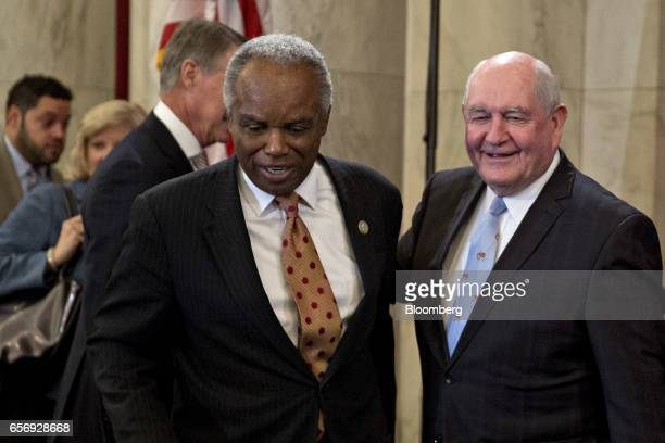 Representative David Scott a Democrat from Georgia left and Sonny Perdue US secretary of agriculture nominee for President Donald Trump arrive to a...