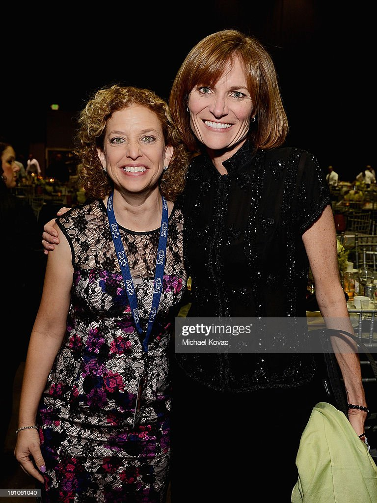 U.S. Representative Debbie Wasserman Schultz (L) and Sr. Vice President at GRAMMY Foundation and MusiCares Foundation Kristen Madsen attend MusiCares Person Of The Year Honoring Bruce Springsteen at the Los Angeles Convention Center on February 8, 2013 in Los Angeles, California.