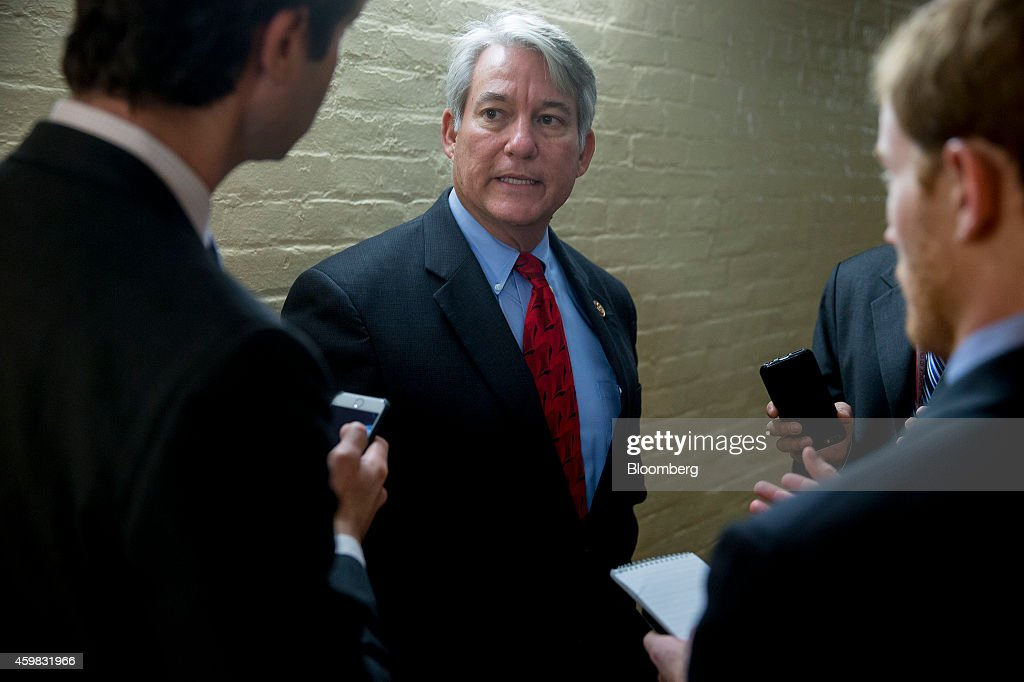 Representative Dennis Ross, a Republican from Florida, speaks to reporters after a House Republican Conference meeting at the U.S. Capitol Building in Washington, D.C., U.S., on Tuesday, Dec. 2, 2014. House Republicans are looking for ways to both keep the government running past Dec. 11 and also send a strong message to President Barack Obama that they reject his authority to stop deporting some undocumented immigrants. Photographer: Andrew Harrer/Bloomberg via Getty Images