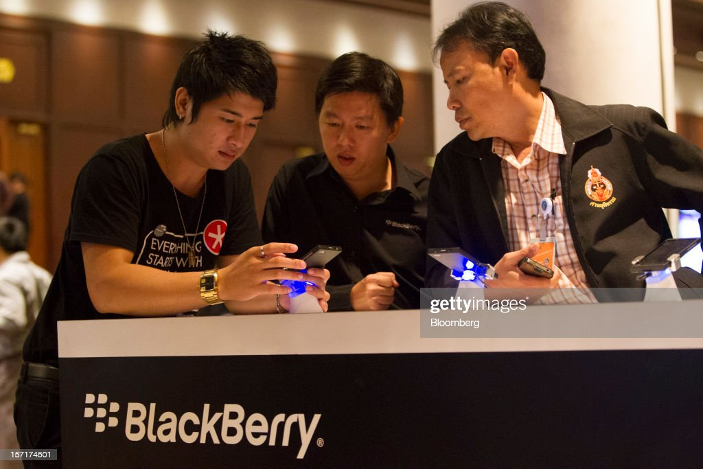 A representative for Research In Motion Ltd. (RIM) demonstrates using the BlackBerry 10 smartphone prototype to attendees at the BlackBerry Jam Asia developer conference in Bangkok, Thailand, on Thursday, Nov. 29, 2012. RIM gained after Goldman Sachs Group Inc. upgraded the stock to buy, saying the new BlackBerry 10 phones could help it return to profitability in fiscal 2014. Photographer: Brent Lewin/Bloomberg via Getty Images