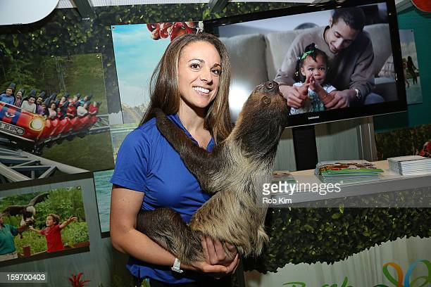 A representative from Busch Gardens holds a sloth at The 10th Annual New York Times Travel Show Ribbon Cutting And Preview at Javits Center on...