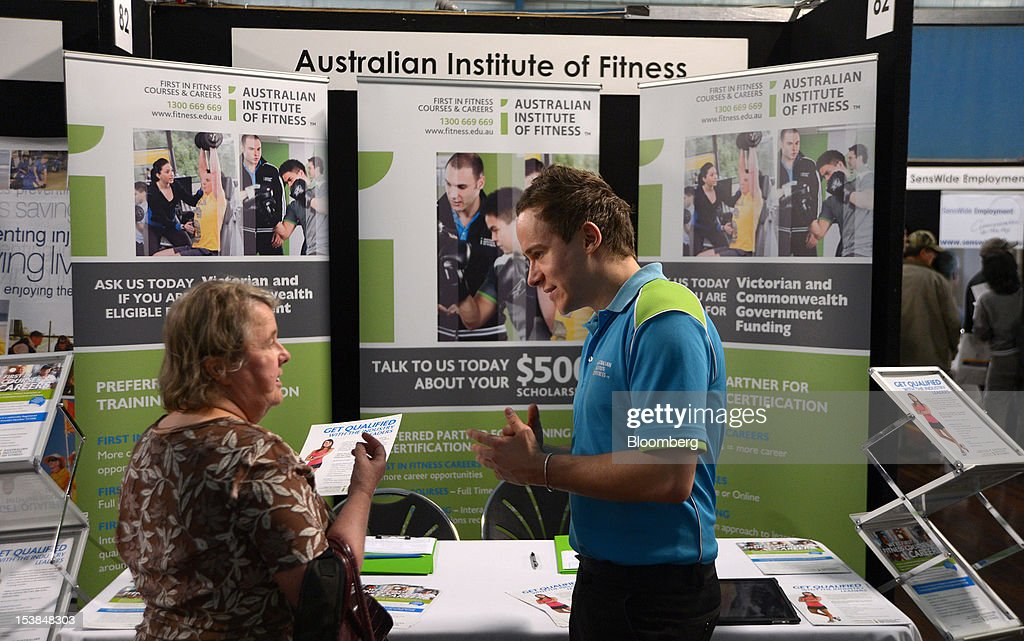 A representative from the Australian Institute of Fitness speaks to a job seeker at a jobs and skills expo run by the Australian government in Melbourne, Australia, on Thursday, Oct. 4, 2012. Australia's unemployment rate probably climbed to 5.3 percent last month from 5.1 percent in August, according to the median estimate of economists surveyed by Bloomberg News. Photographer: Carla Gottgens/Bloomberg via Getty Images