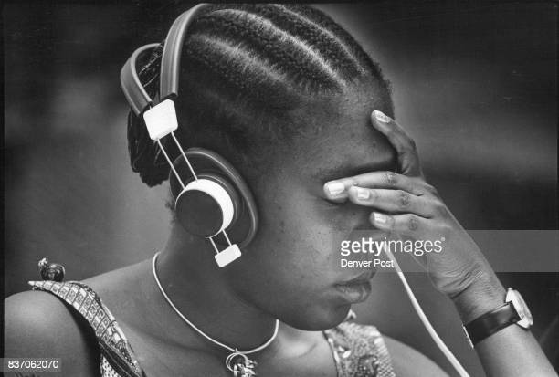 Representative from the ivory coast listens intently to translation on Headset Credit Denver Post