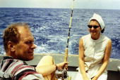 UNDATED Representative Gerald R Ford relaxes with his wife Betty Ford while deepsea fishing during a Caribbean vacation in this undated 1972 handout...